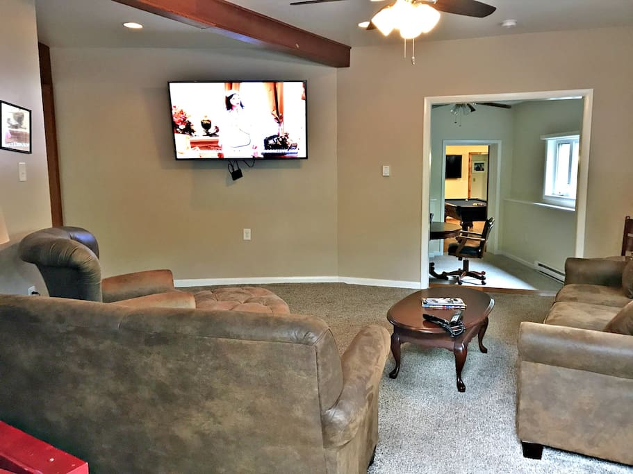 """Living tv area with 65"""" flat screen smart tv"""