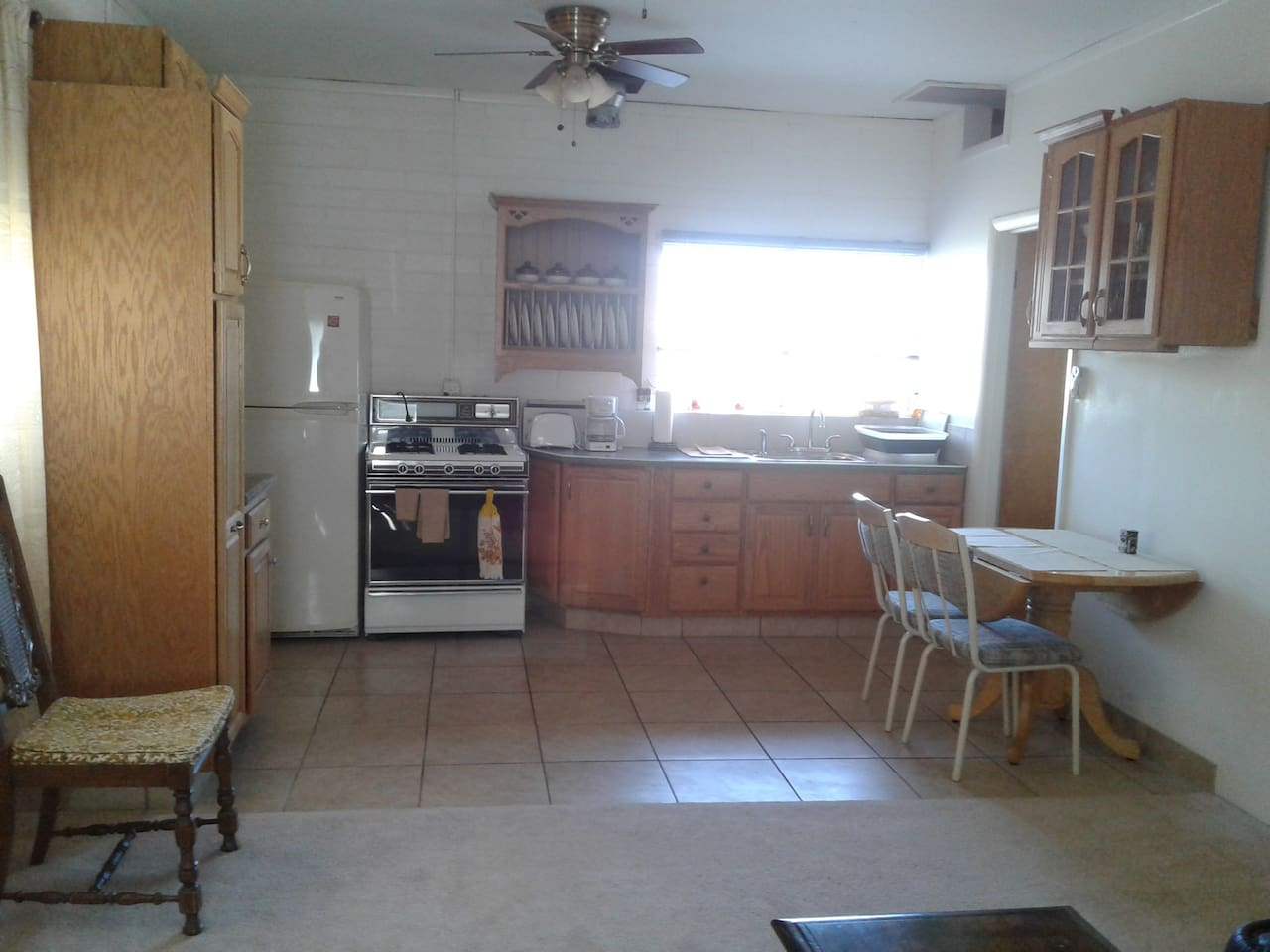 Kitchen area is fully equipped with everything one would need.