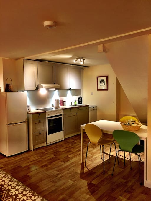 Kitchen and dining area.  Kitchen includes fridge freezer, cooker, dishwasher and all usual amenities.