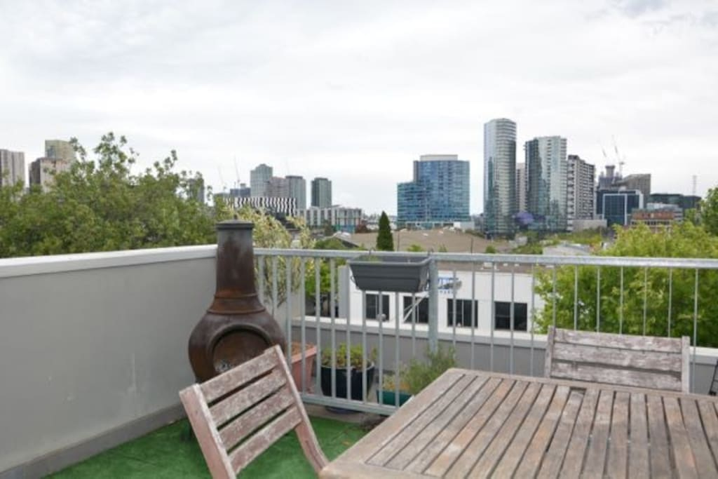 The spacious rooftop terrace has views over the city and Docklands