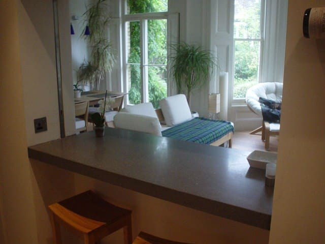 Kitchen - overlooks living area and private garden