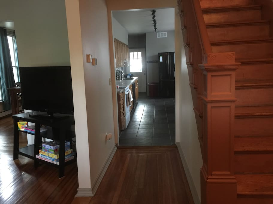Front entrance, living room/dining room on left, kitchen in front and copper stairs on right