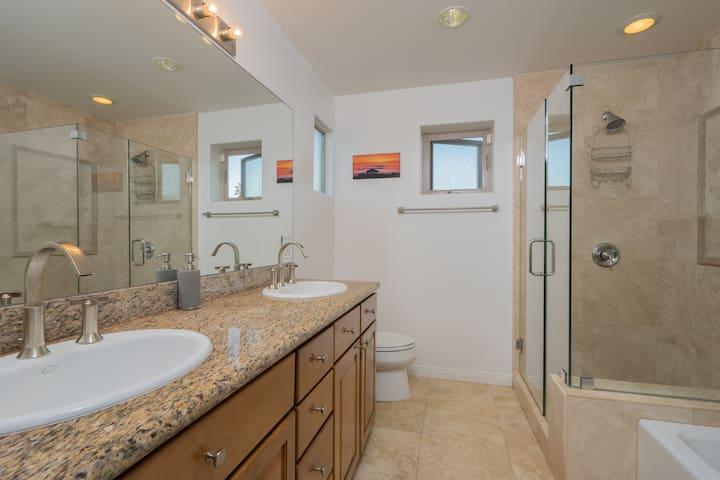 Beautiful master bathroom includes dual vanity, shower and bathtub