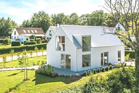 Magisk havsutsikt i nybyggt arkitritat hus. 140kvm