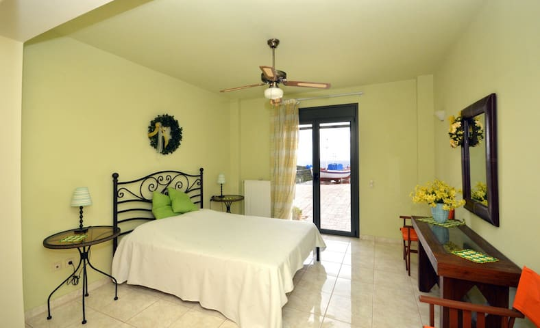 Aphaia Villa II - Lower Ground (Pool) Level - 3rd Double Bedroom with direct access to the pool