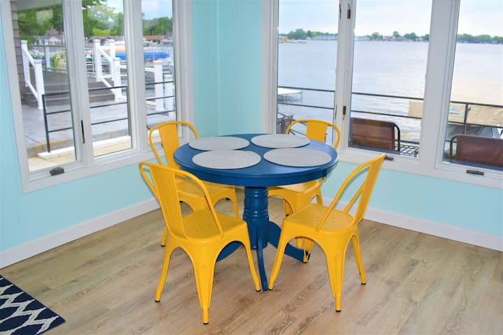 Dining area in sun room overlooking the lake.