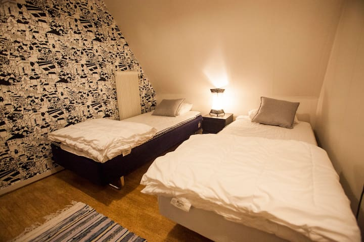 Second bedroom with two single beds. Can also be moved together to act as a double bed.