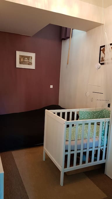 Bedroom with a double bed and a baby bed