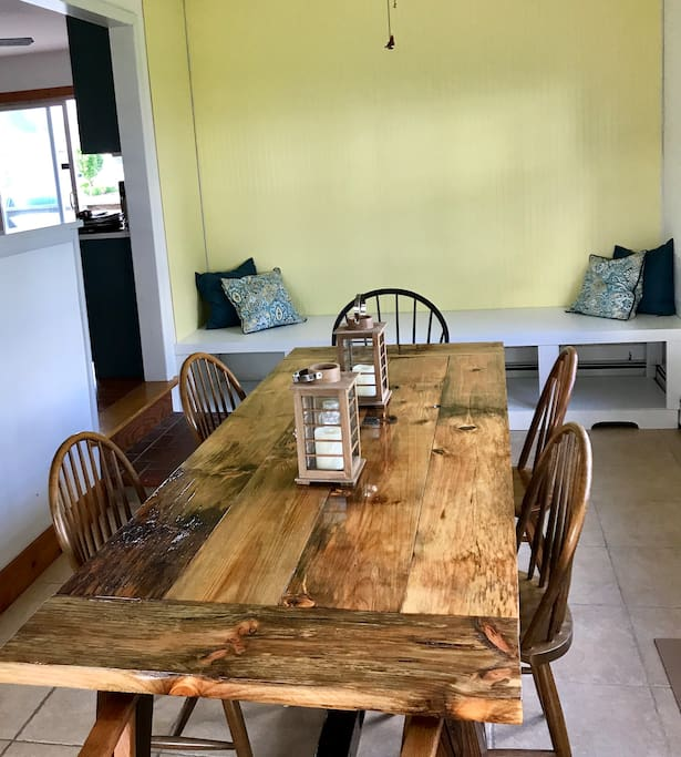 Family meals at the custom dining table and lots of room to relax and watch the bay on the built in bench.