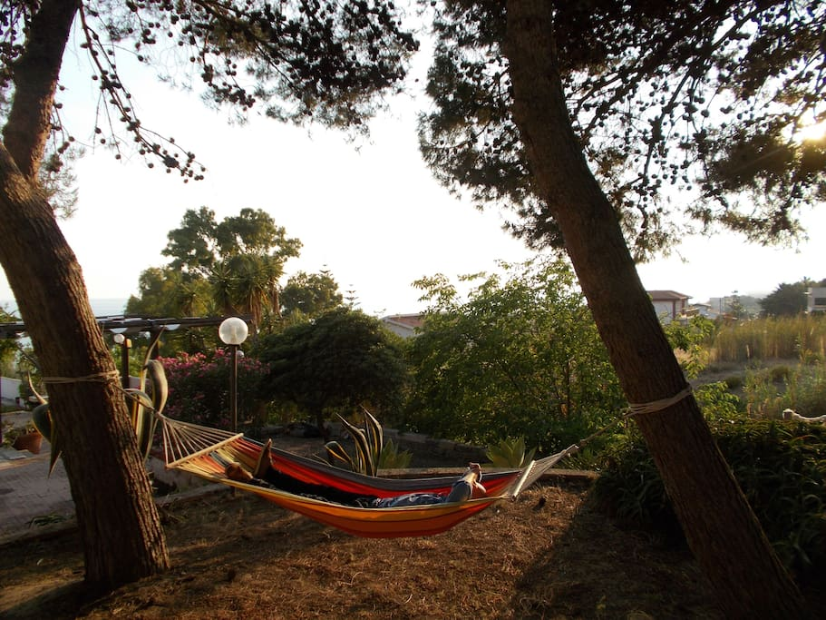 Pleasant moments of relaxation on the hammock in the pine forest overlooking the sea