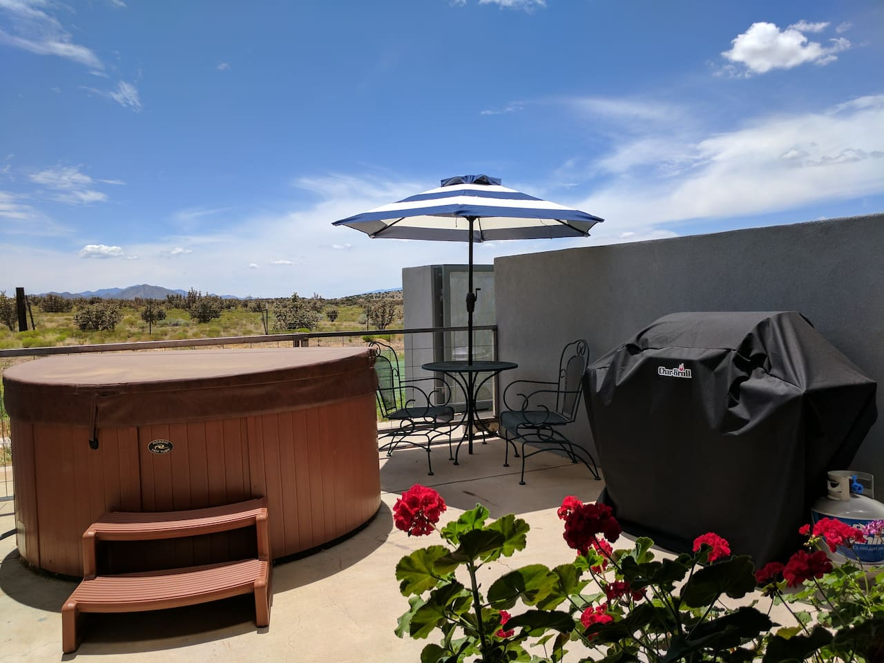 Private Patio:  Bask under the true blue New Mexico sky -- or night sky studded with stars and the Milky Way -- on your patio with spa, grill, bistro table, chairs and view to open land (our friendly dog is fenced off from all your spaces).
