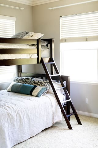Twin over Full Bunk Bed with attached full bathroom.
