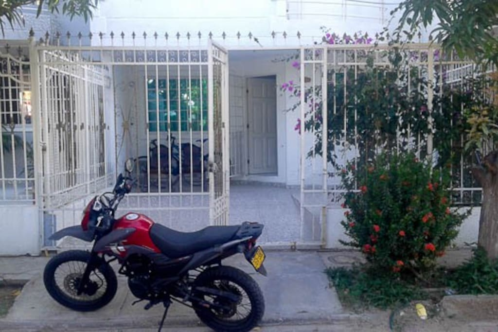Our front door with motorcycles and bicycles to hire should you wish