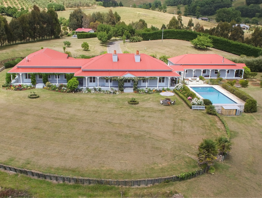 French colonial-style homestead set within 16 acres of gardens and grounds
