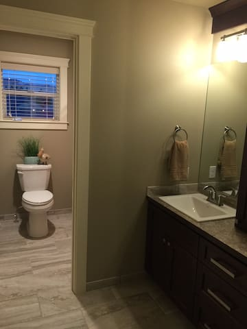 This bathroom features two sinks and a separate room for the toilet and bath/shower.  It is closest to the 'Americana' guestroom.