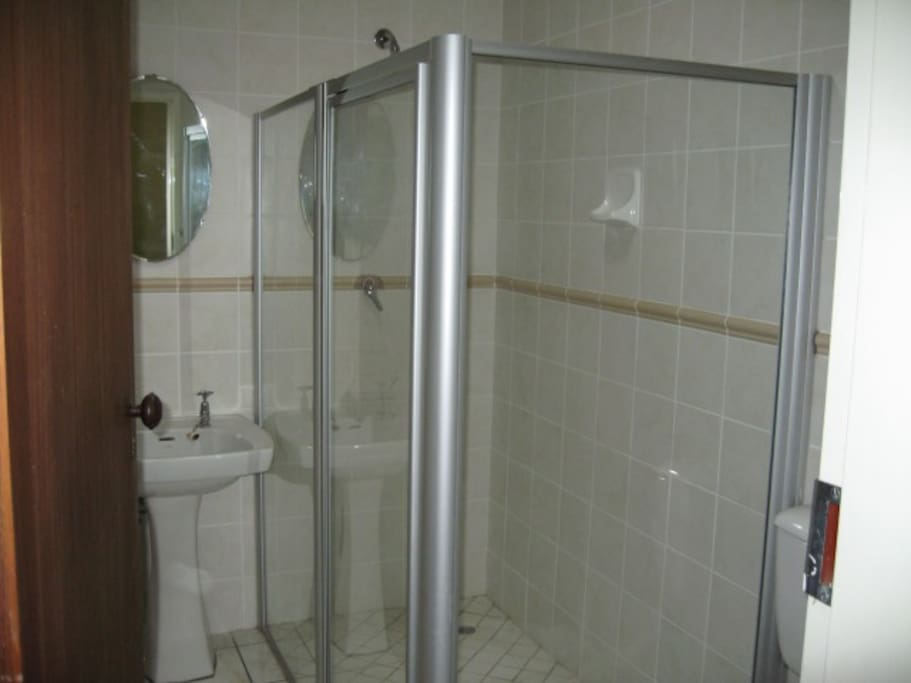 Large shower can accommodate two people at the same time.