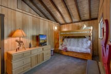 Bunk room with queen size bed, twin bunk and twin trundle