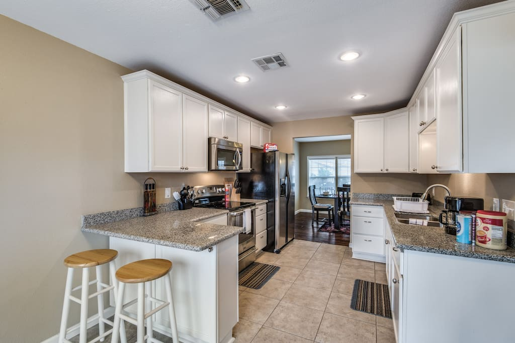 Clean, spacious kitchen with modern appliances