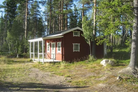 Charming little red cottage located in absolute secluded location, right on the lake