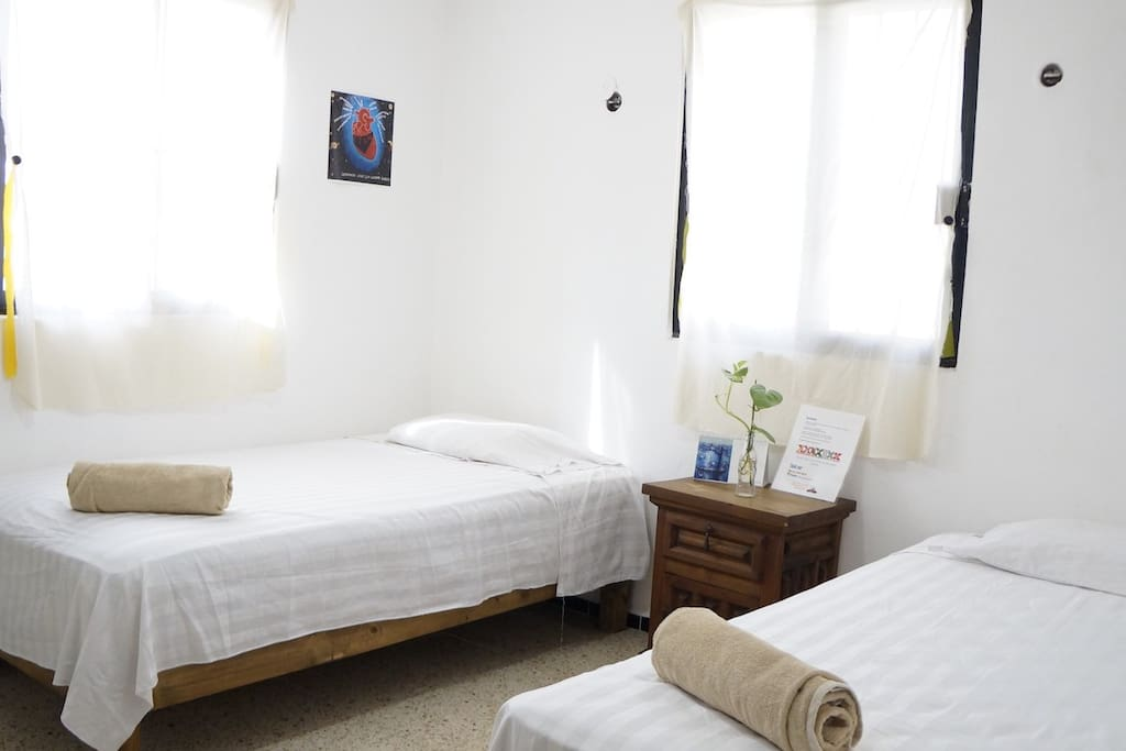 Private room with two single beds, big closet, towels, air conditioner and fan