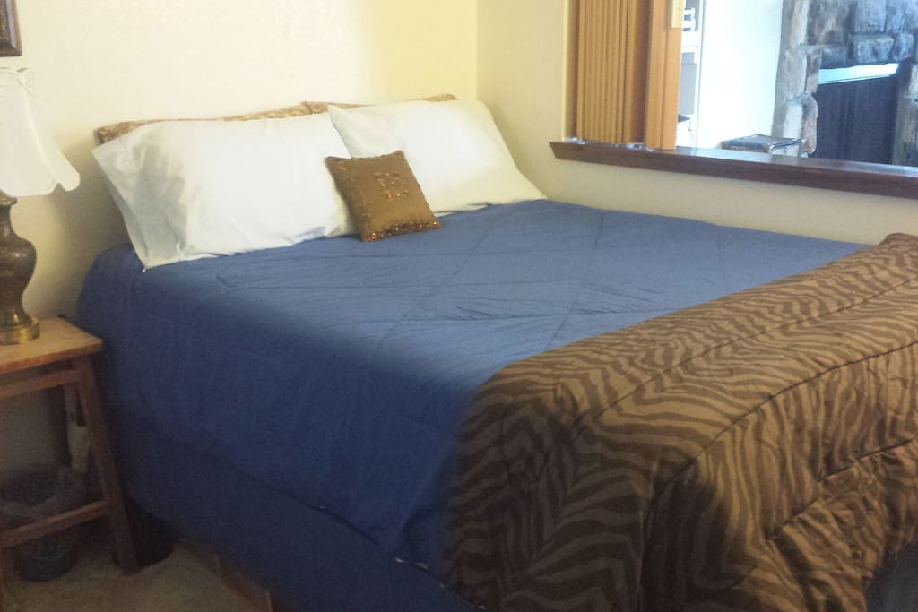 Queen-size bed. Screen closes over window for privacy. When open, gorgeous views of Lake Tahoe.