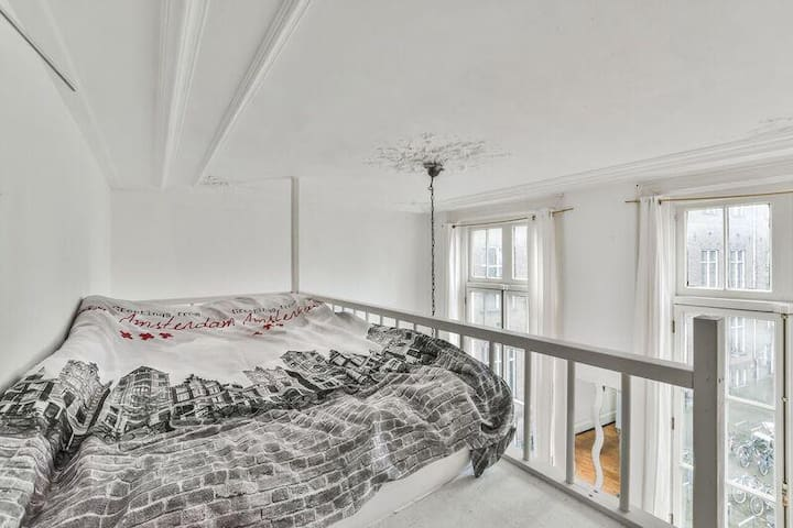 Bed on the elevation in the room