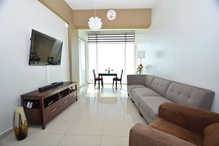The apartment is new and has tile floor throughout the apartment. It is modern and clean.