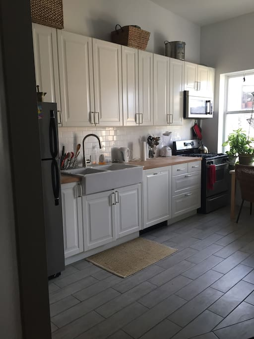 Chef's kitchen with gas stove, dishwasher, kitchen table