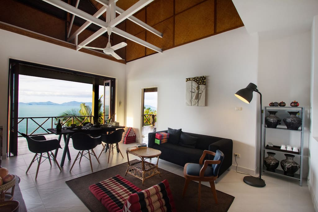 """The open plan living, dining and kitchen area (4.20x7.00m) has an exposed vaulted ceiling with ceiling fan, a 32"""" flat screen tv and bi folding doors leading onto the covered terrace."""