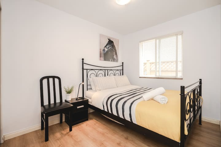 Large queen size bed in the spacious 1st bedroom.