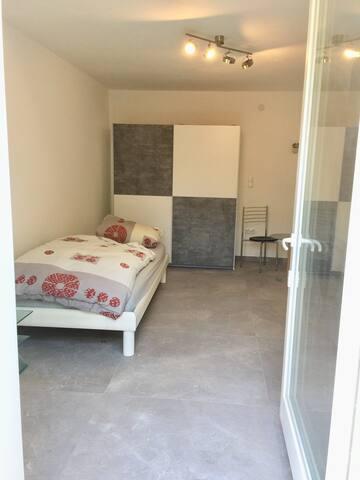 Cozy flat in paradise garden 20min from Munich