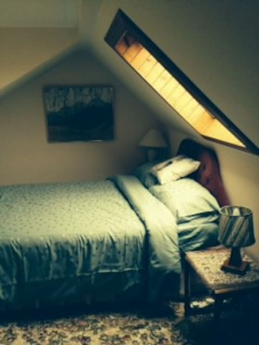 Attic bedroom showing the window with sea view.