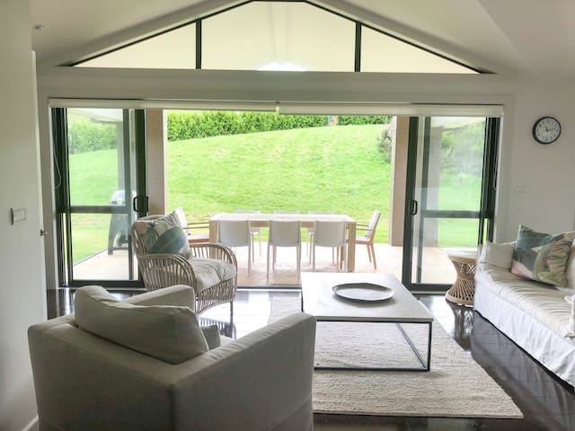 Open plan kitchen area with easy access onto sunny/ sheltered outdoor lawn and dining