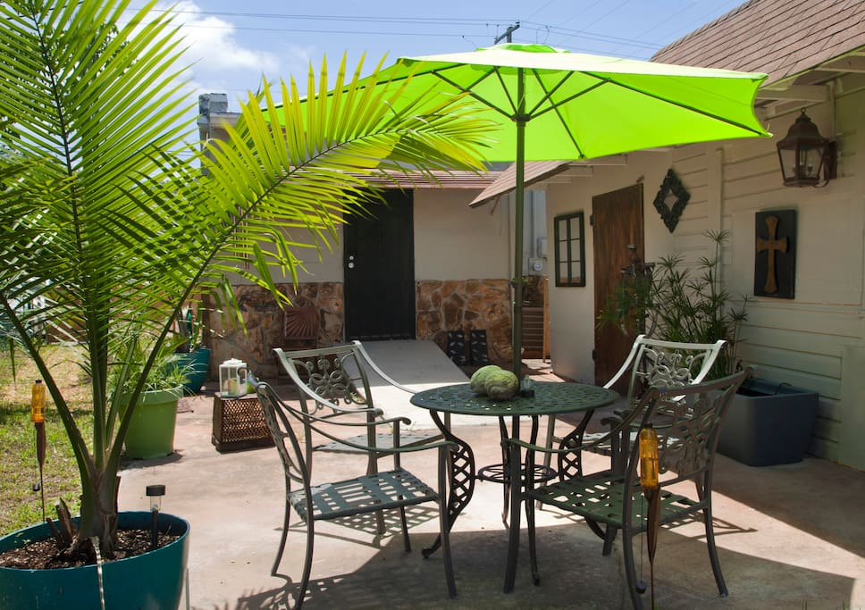 An outdoor dining set for 4 with umbrella.