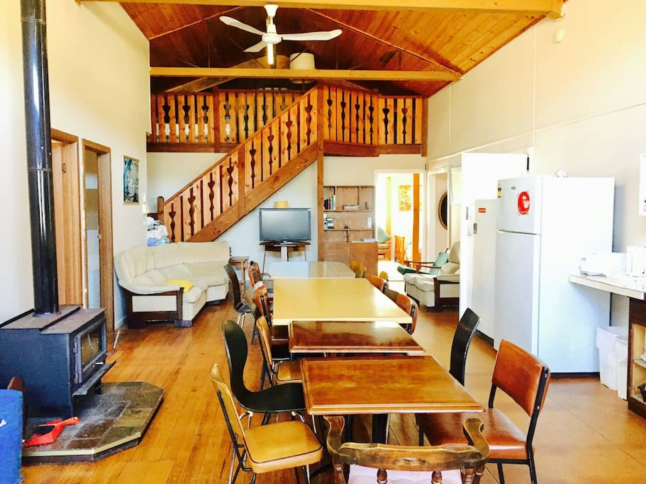 Big 15+ people dining room with three fridges, fire place, air-con, fan. Up-stairs have two or more single beds for kids.