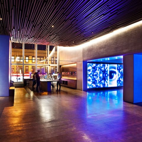 The reception area is flanked by two light sculptures on which groundbreaking local artist Yorgo Alexopoulos projects an abstract tableau of graphic animations timed throughout the course of a day in New York.