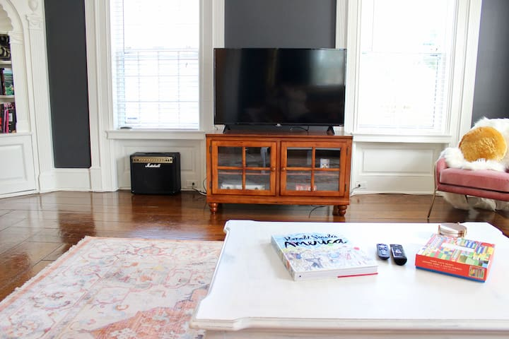 Smart TV with cable. Board games include complete poker set, chess set, puzzle, memory game, and more.