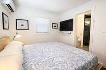 Master bedroom, complete with TV