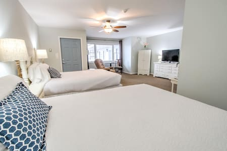 East Shore Lodging - Boutique motel ADA accessible guest room with the comforts of home and the luxuries of travel - Boat Rentals available.