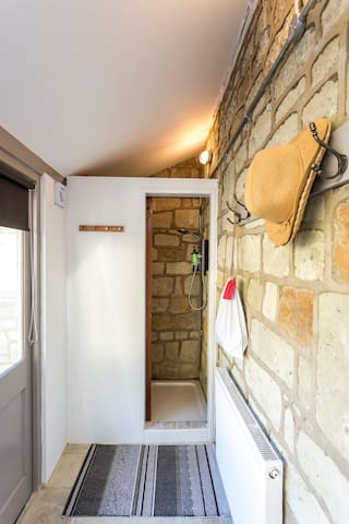 Unique shower room with stone wall
