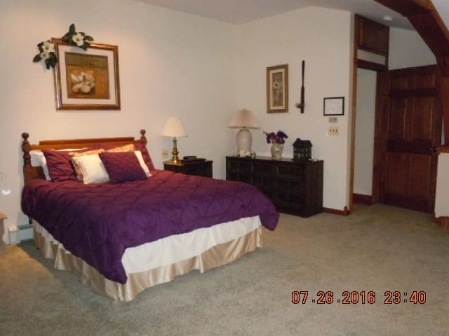 22' x 22' huge bedroom, 2 queen beds, Window air conditioner, Each room has it's own thermostat for heat control,  Each room has a ceiling fan, Has a wicker love seat & 3 wicker chairs, Has a desk.