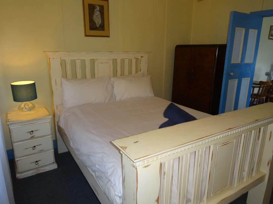Queen size bed in the master bedroom