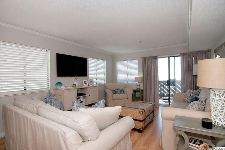 living room looking toward balcony and ocean