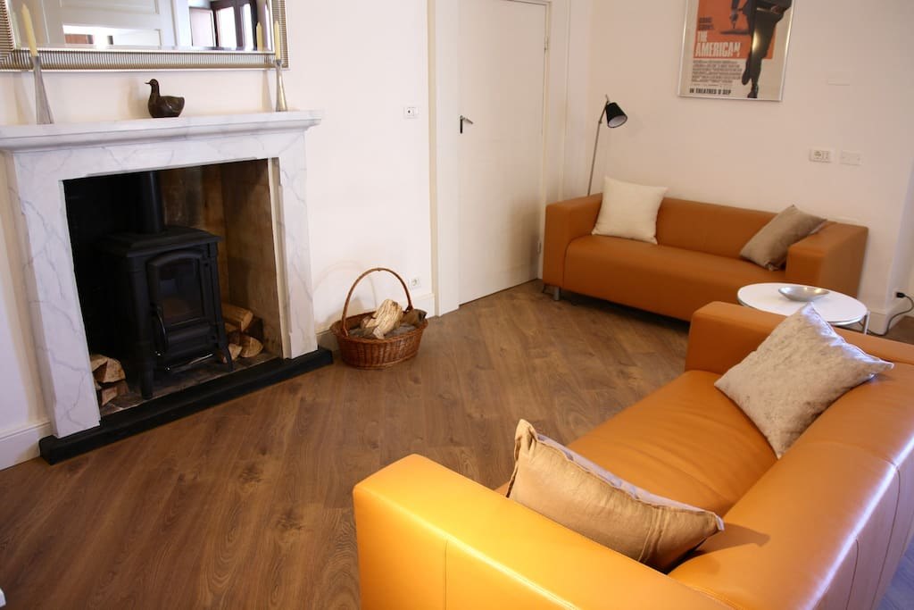The spacious living room has 2 comfy sofas and a functioning wood-burning stove.