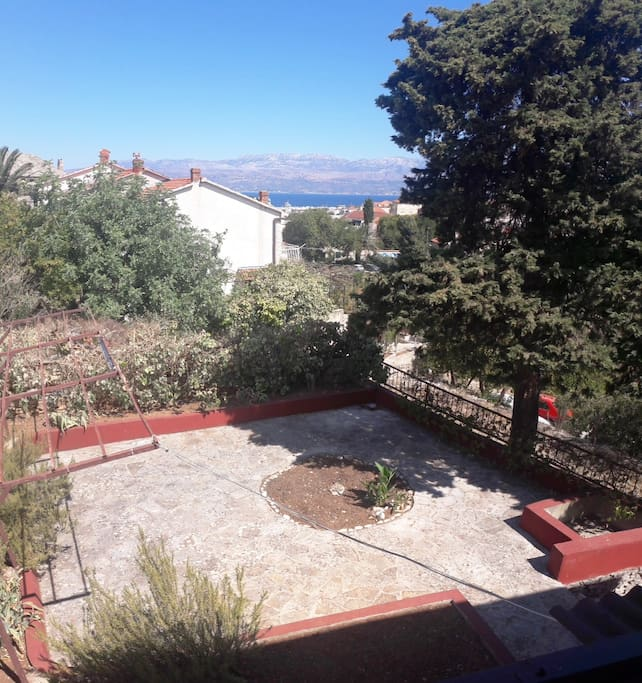View from the bedroom on the flower garden and sea with Biokovo mountain.