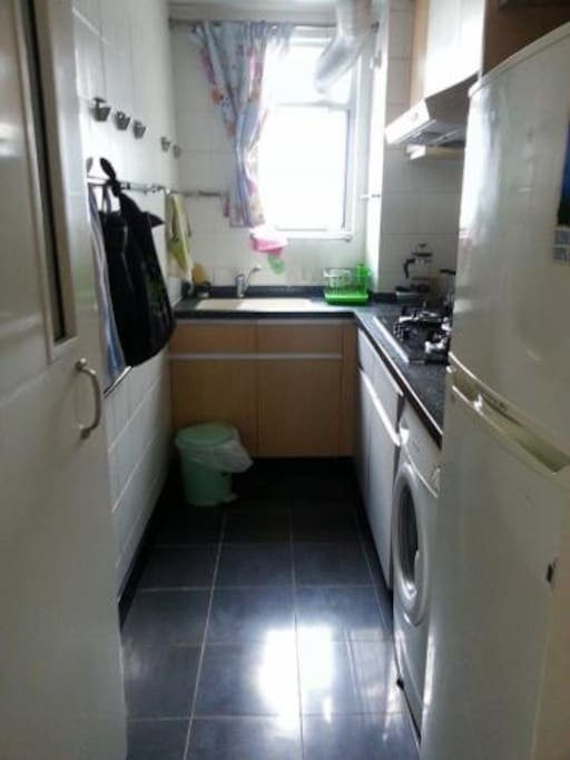 Full kitchen with washer and fridge