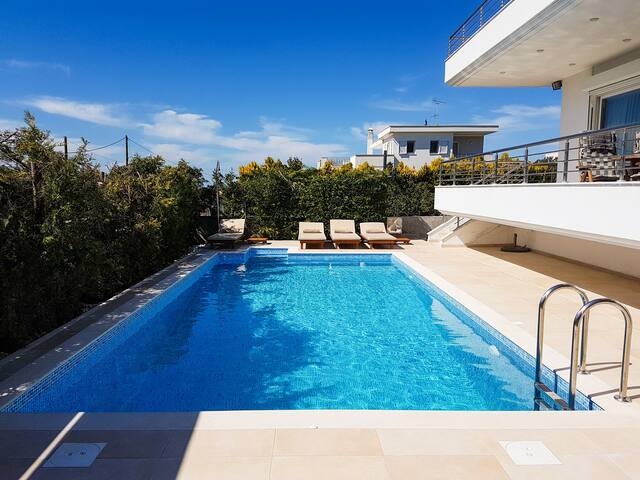 Modern villa with heated pool-5' from the beach.