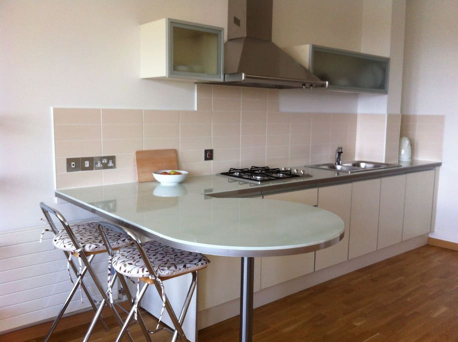 Comfortable breakfast bar, and fully fitted kitchen.