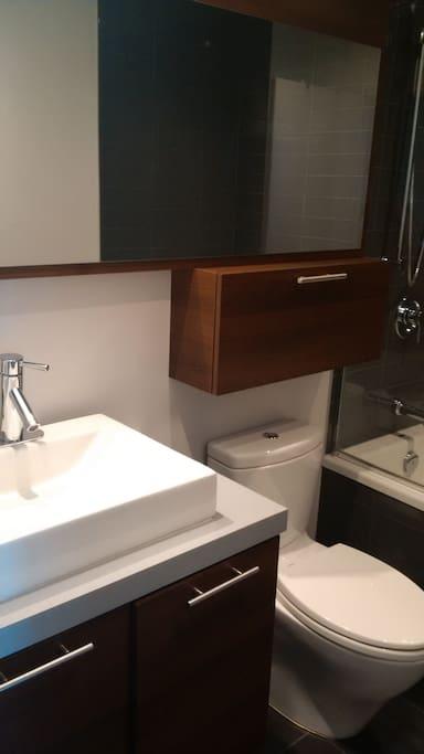 Full bathroom with deep tub