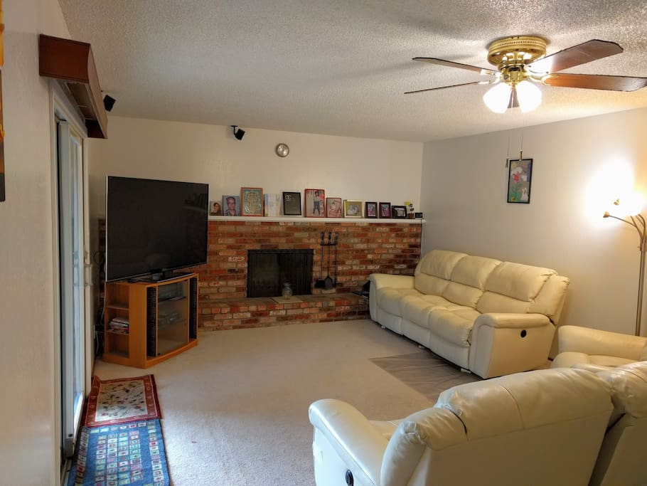 Common family area has leather recliner sofas (electric), 65 inch TV, Bose surround sound system and fireplace